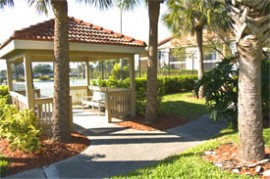 Outdoor amenities at Vintage Grand include tennis courts, resort style pools and a community fishing dock.
